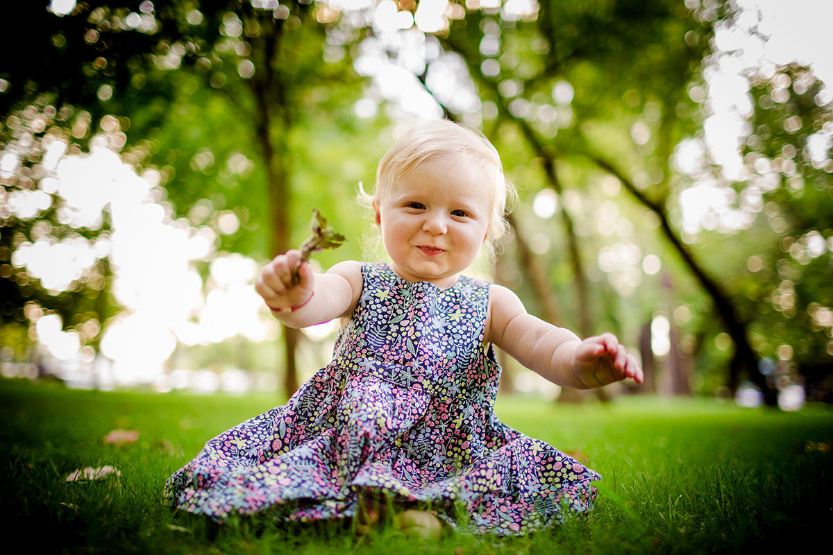 Family photography in the park little blonde girl portrait