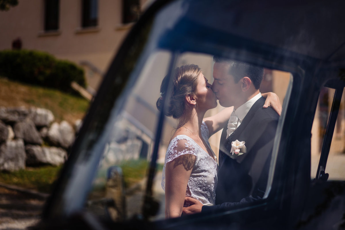 Bride and groom kiss - Wedding in French Alps