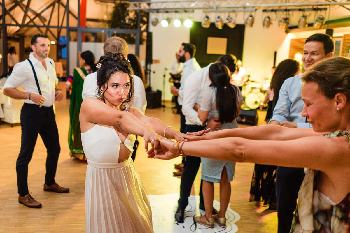 Bride is having fun at wedding